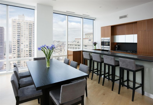 Photo of dinning table and the kitchen in one of the most beautiful penthouses