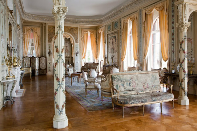 Louis XVI Furniture, Beautiful Drapery And Carpets Completes The Palatial  Salon.