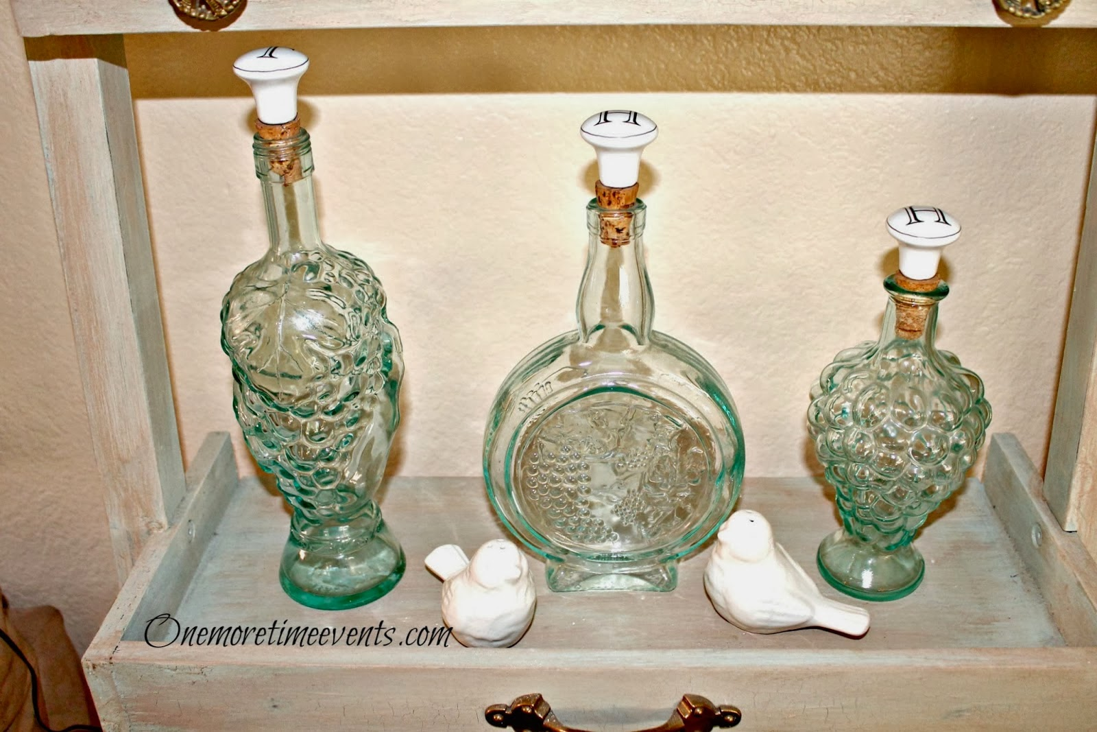 Monogram knobs added to green bottles at One More Time Events.com #monogramknobs,#greenglassbottles