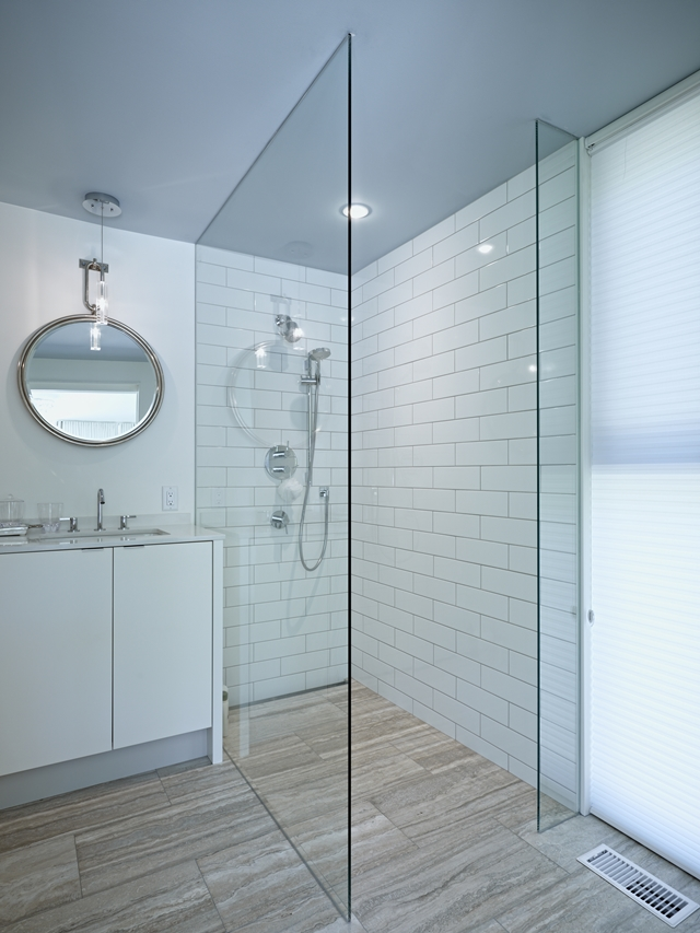 Picture of modern glassy shower cabin in the bathroom of Clearview Residence