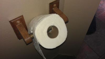 practical joke, toilet paper, toilet paper front or back, toilet paper on sideways, tp