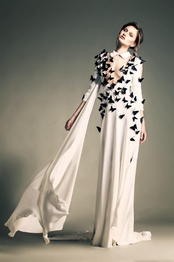 haute couture défilé de mode sabaji styliste libanais , robe blanche incroyable avec des papillons sculptés