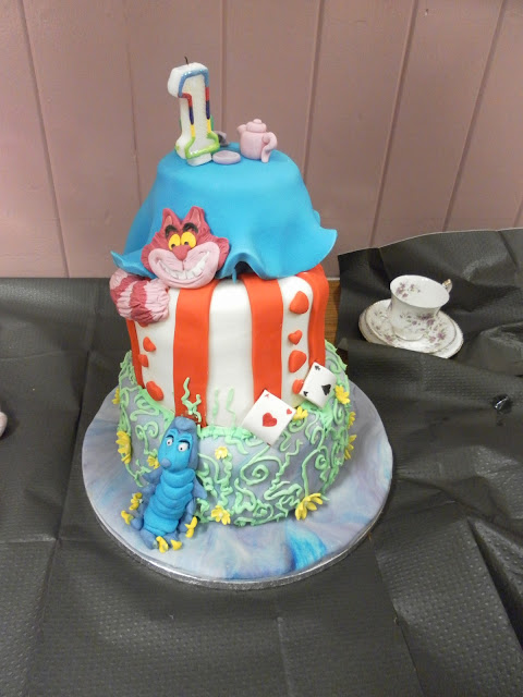 A picture of an Alice in Wonderland birthday cake