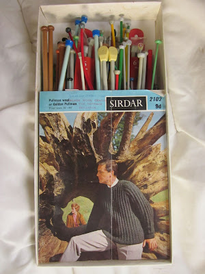 Box containing knitting needles and pattern for a jumper