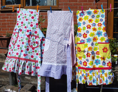 Colourful aprons hanging on the washing line
