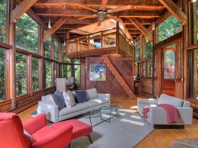 Photo of living room inside of tree house in the forest