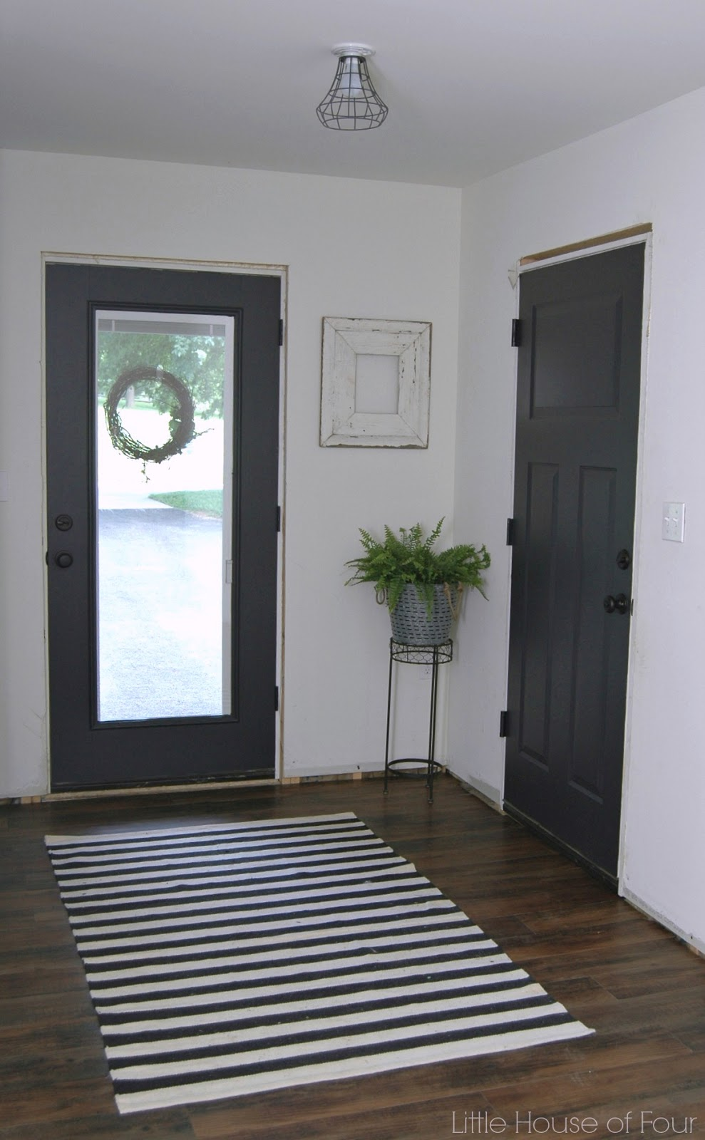 Mudroom progress paint makes all the difference little for Interior door paint designs
