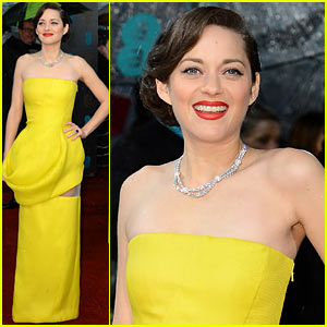 Vintage inspired up do worn by Marion Cotillard, with a sleek finger waves. worn to the side for a modern twist. sleek glossy finish