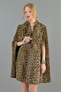 Vintage 1960's leopard print military style cape with front arm openings.