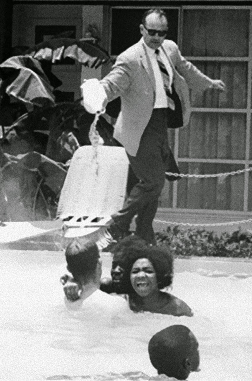 The manager of the motel, James Brock was photographed pouring muriatic acid into the pool to get the protesters out.