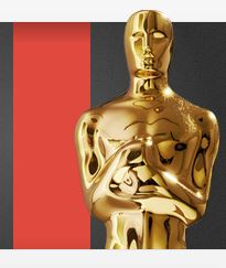 Gold Oscar Statuette by a red carpet