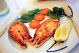 Stock photo of grilled fish with lemon