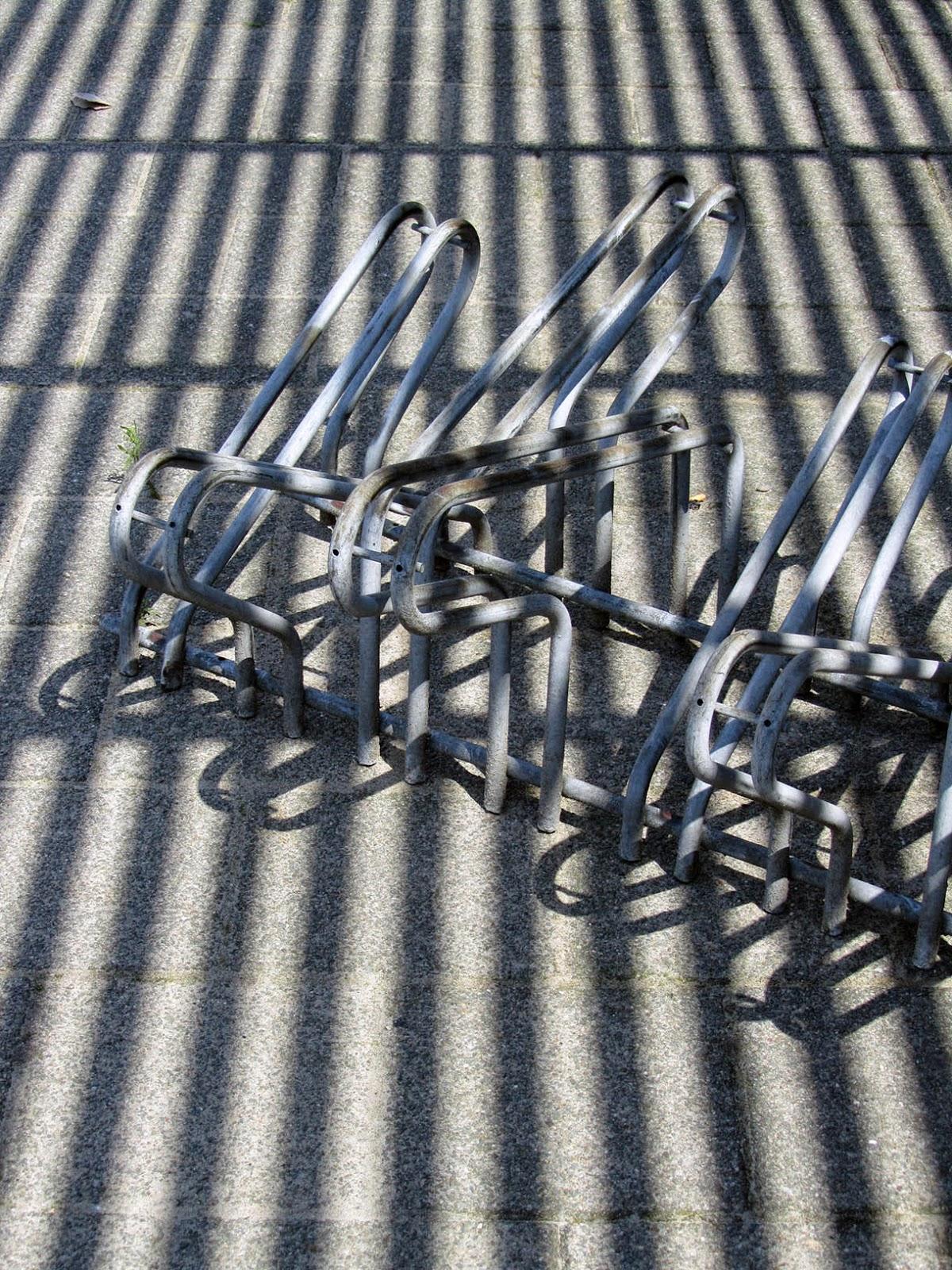 shadows on bicycle rack