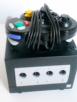 Black Nintendo GameCube with controller