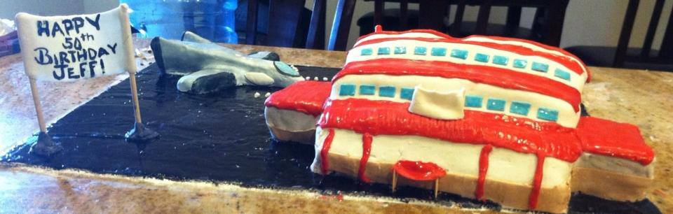 Airplane hangar and jet cake