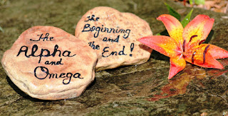 Alpha and Omega written on stones