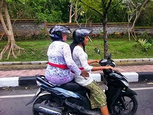 Indonesian women on the scooter