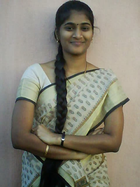 Homely Long Haired Kerala Women Wearing Saree