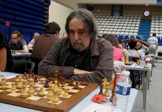 Echecs à Paris : Thierry Manouck miniaturisé par Namig Guliyev © Chess & Strategy