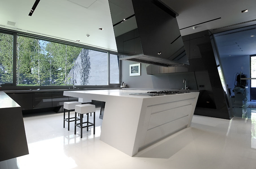 Kitchen in Ultra Modern Concrete House by A-cero Architects