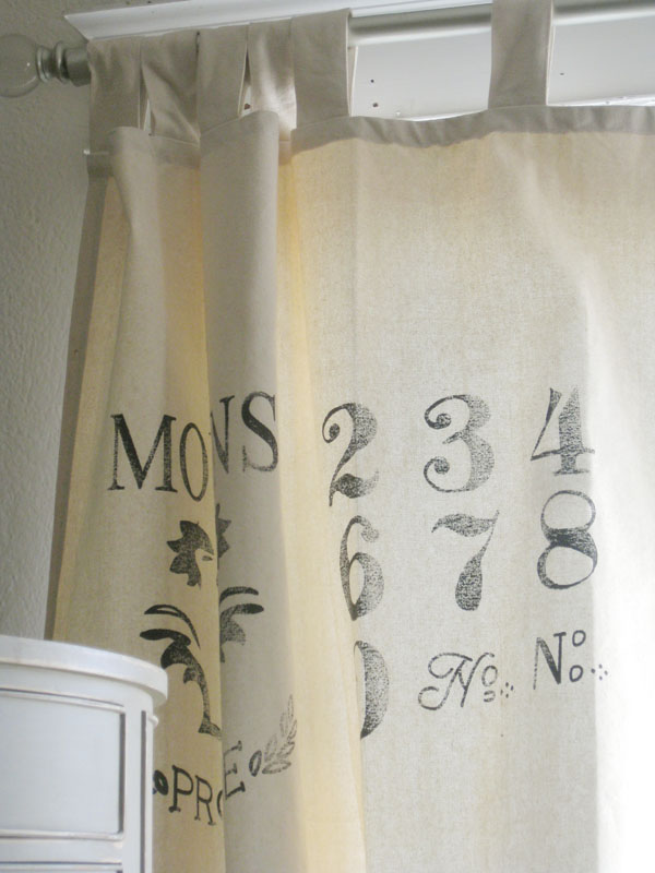 i think the stenciled detail on the curtain panel is very charming something easy to diy on drop cloth curtains