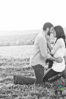 black and white of couple hugging after proposal