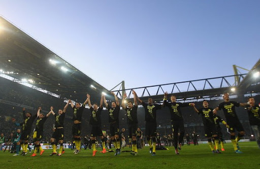 Borussia Dortmund players celebrate after winning the Bundesliga title for the second year in a row