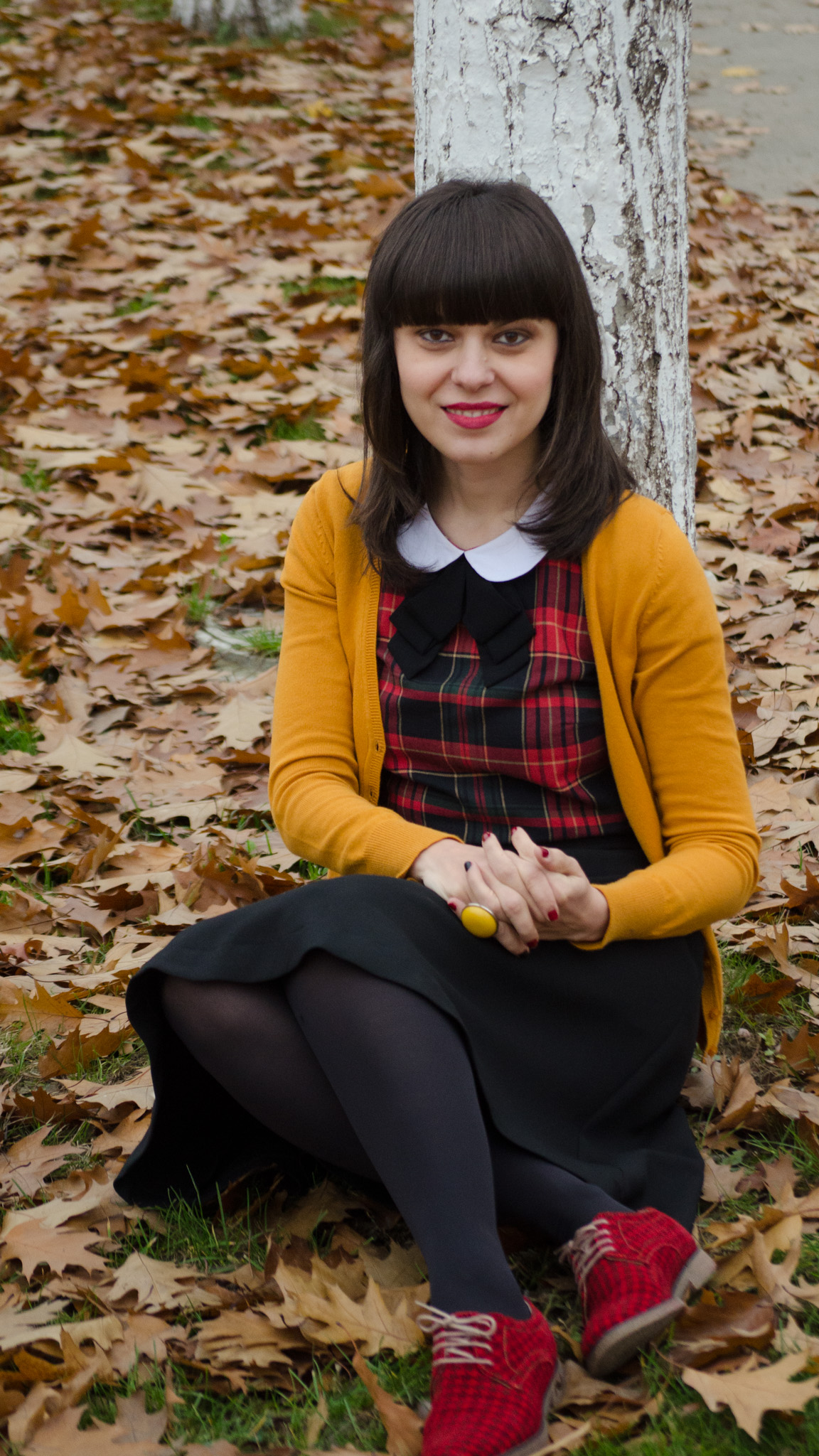 houndstooth oxfrod shoes mustard sweater tartan shirt peter pan collar black a-line skirt fall leaves school outfit bow