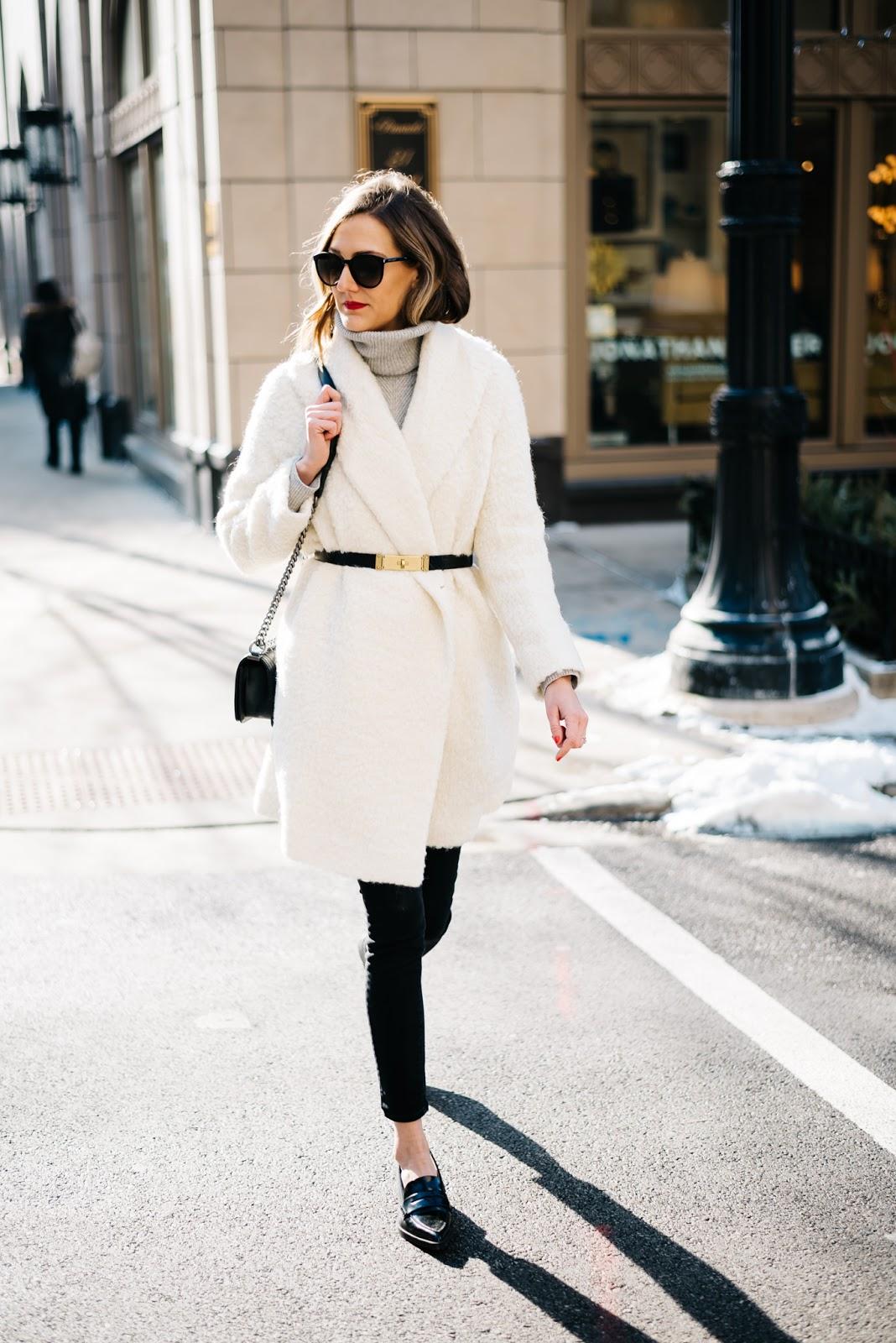 white fuzzy coat