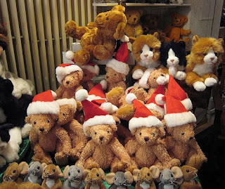 Christmas teddy bears with Santa Claus hats photo