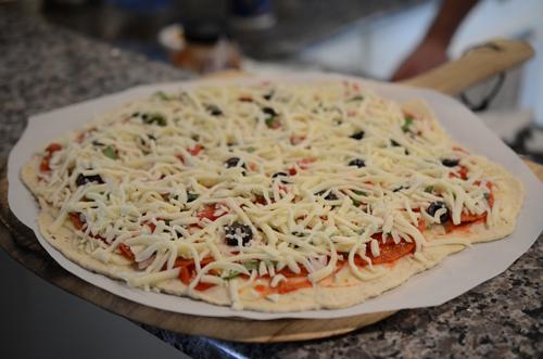 pizza peel, pizza, parchment paper