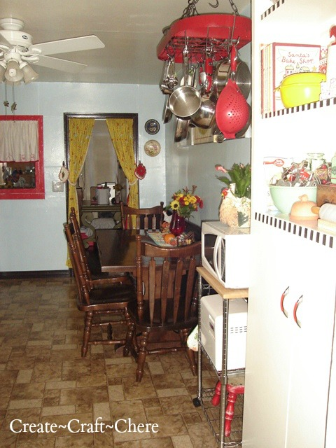 Retro kitchen makeover turqoise blue with red pot rack and Mary Engelbreit inpirations