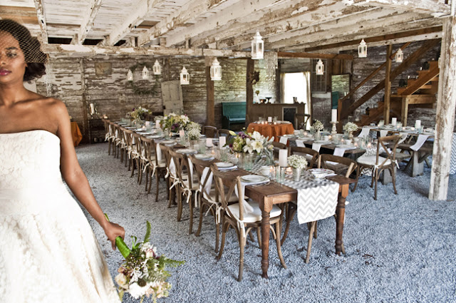 Vintage Rustic Farm Wedding Catskills shot by fine art wedding photographer Angela Cappetta view of room set for dinner in barn