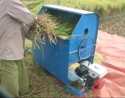 Alat perontok padi mesin