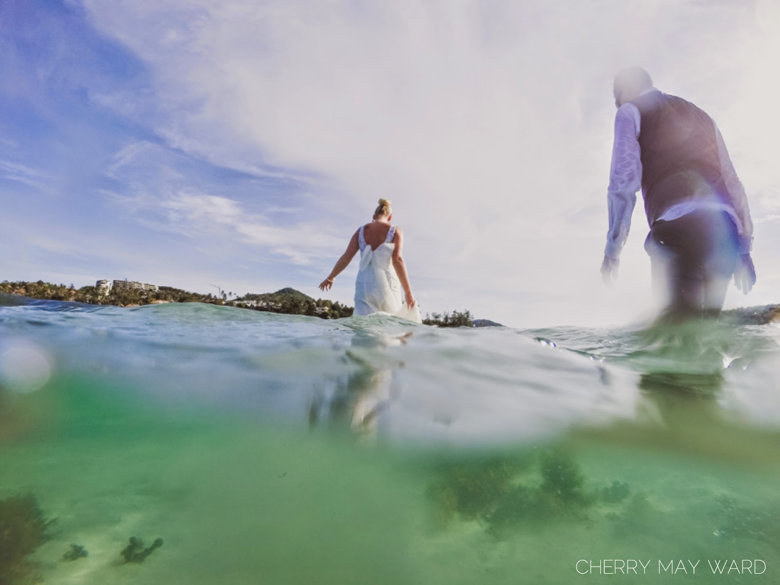 bride and groom walking out of the water on Koh Samui, Chaweng beach, Thailand trash the dress,