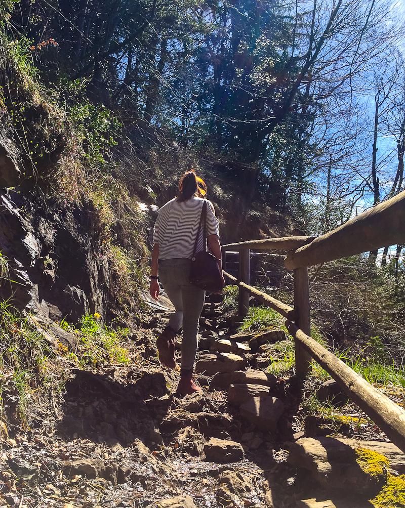 Climbing up the rocky steps of Harder Klum in Interlaken Switzerland