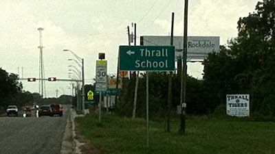 Street sign pointing to the Thrall School.