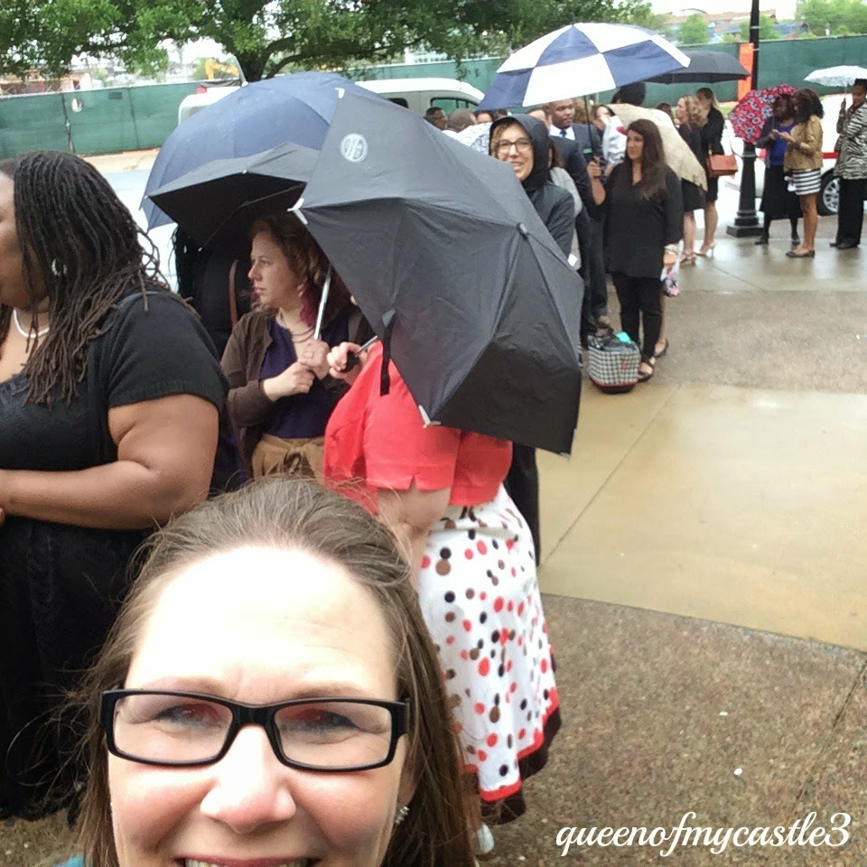 People waiting in the rain for doors to open to see the President