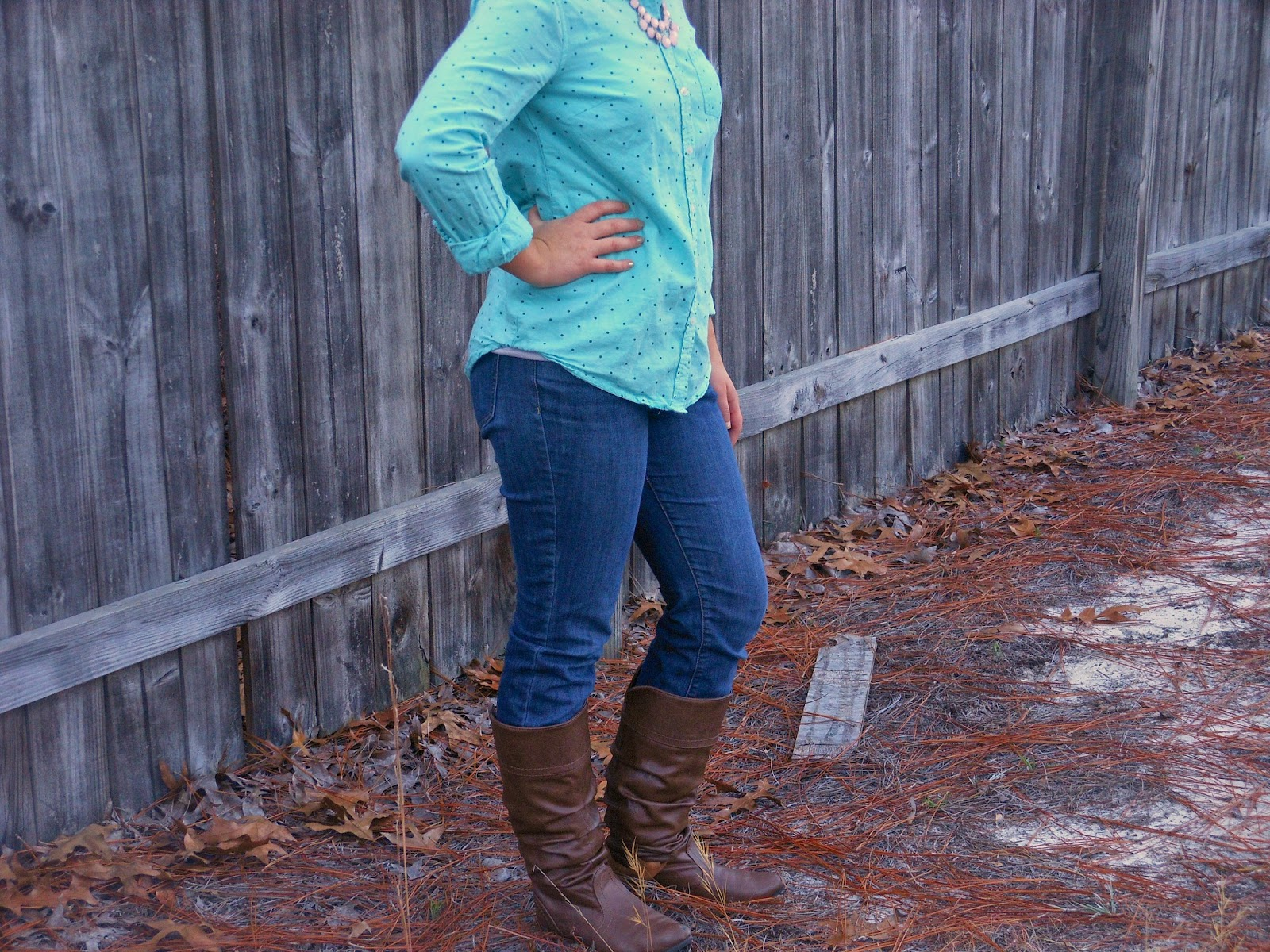 Turquoise and Light Pink. polka dot button down, pink necklace, jeans, brown boots.