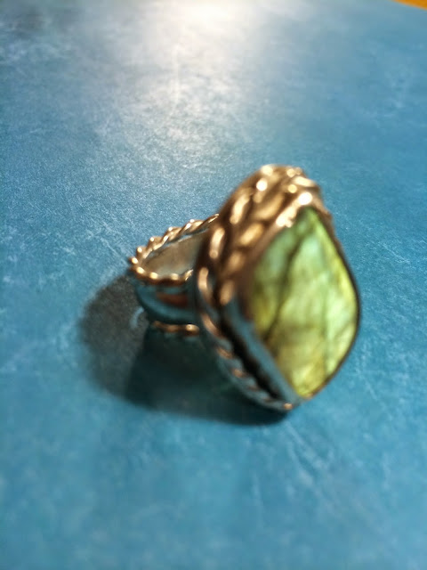 Labradorite silver ring with twisted silver wire around the bezel and shank