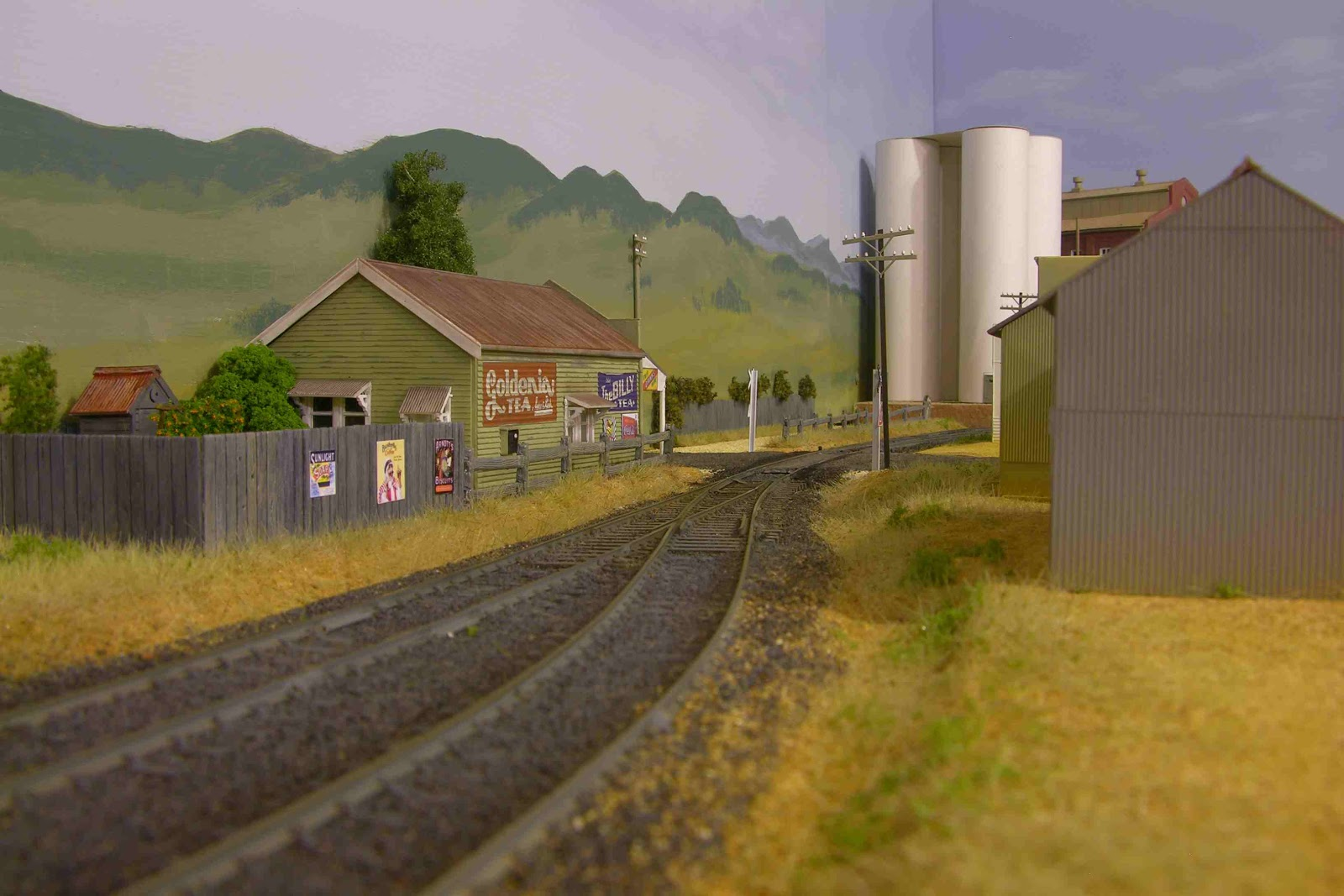 bylong level crossing and a backyard
