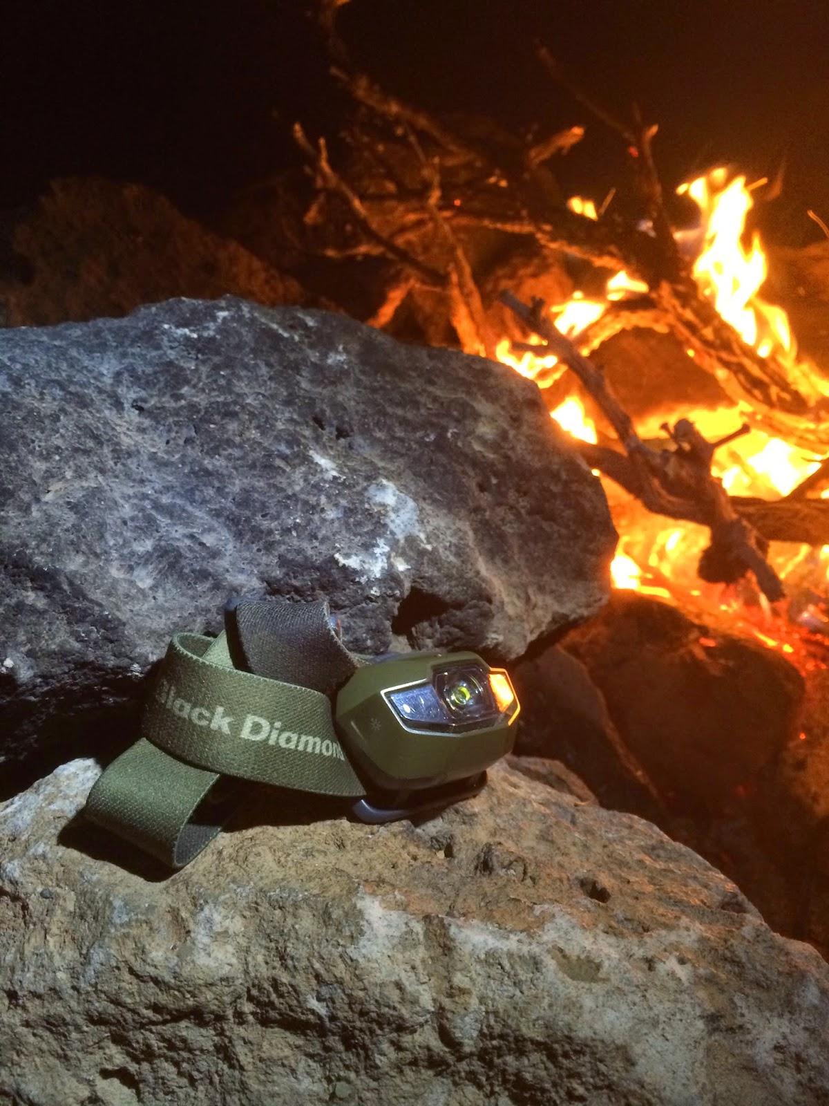 Black Diamond Spot Headlamp next to a fire