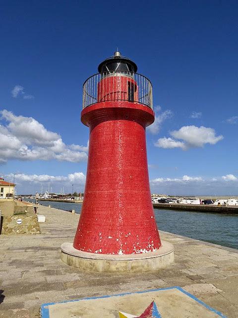 Lighthouse at the entrance of the marina, Castiglione della Pescaia