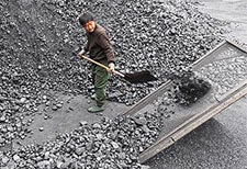 A worker shovels coal at a mine facility in Anhui province in eastern China. (Credit: AFP/Getty Images) Click to enlarge.