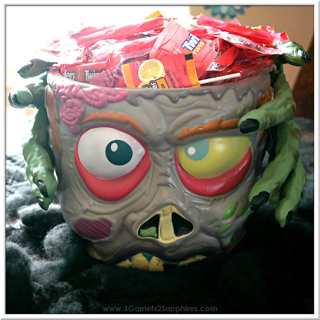 Easy DIY Scary Hands Holding Zombie Head Halloween Centerpiece  |  www.3Garnets2Sapphires.com