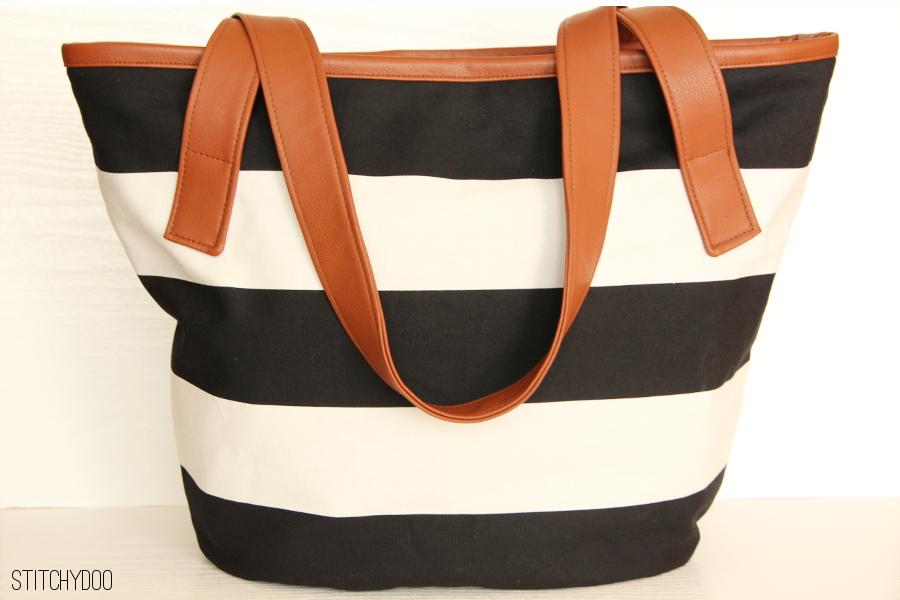 stitchydoo: Handtasche schwarz/weiß mit braunem Kunstleder