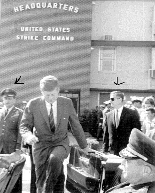 11/18/63, FL: SA Don Lawton near rear of limo as military aide Godfrey McHugh looks on