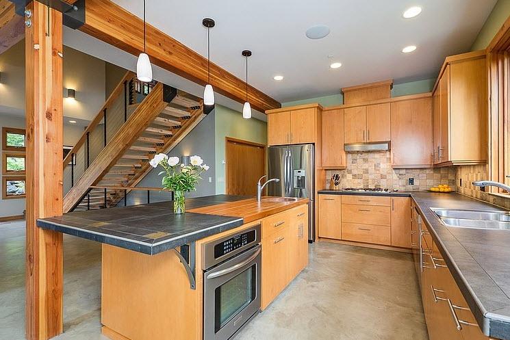 Dise o de casa moderna en la monta a rodeada de vegetaci n for La cocina en casa