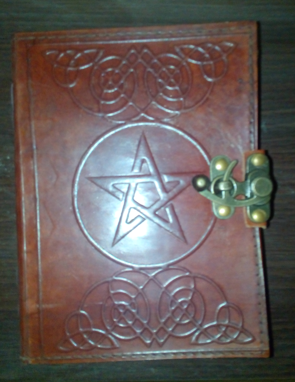 A Wiccan Pentagram Book of Shadows.