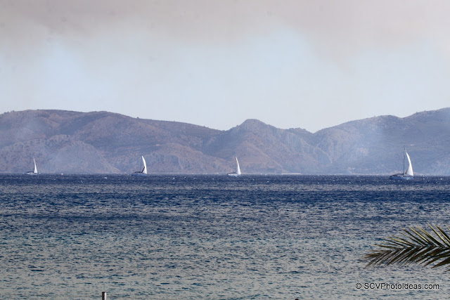 Four sailboats in the horizon